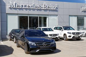 Picture of Several Mercedes-Benz Sitting at a Dealership