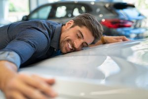 Photo of a Happy Driver Hugging Their European Car