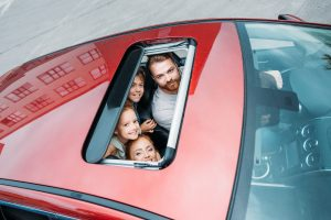Family Looking Out of the Car Sunroof